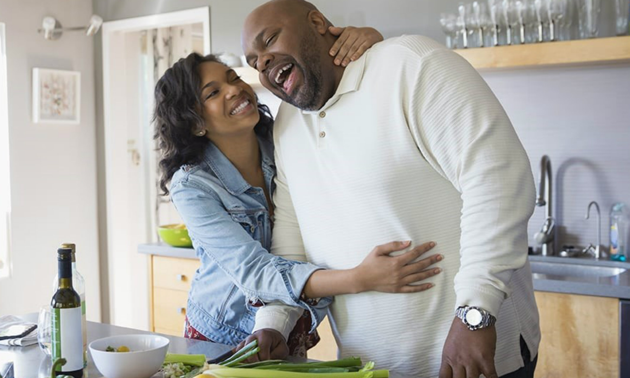 Man and woman who present as black standing in the kitchen