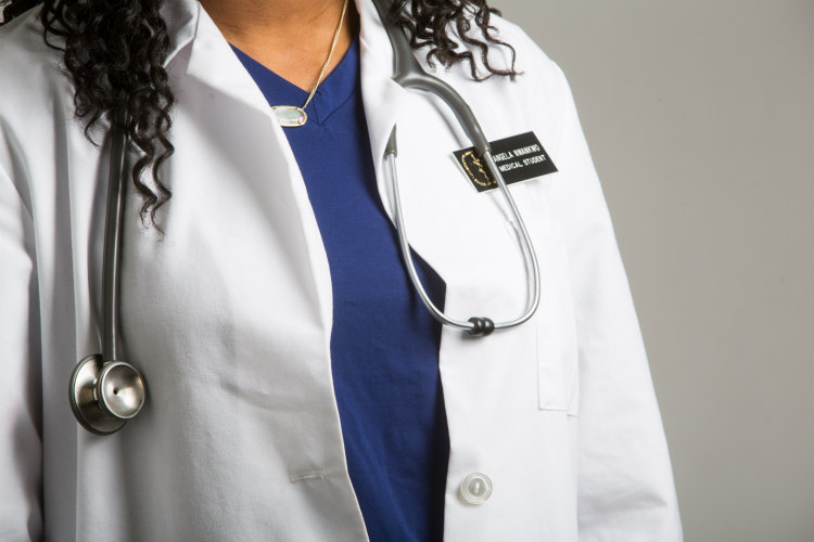 Closeup of medical student Angela Nwankwo's white coat, showing a stethoscope