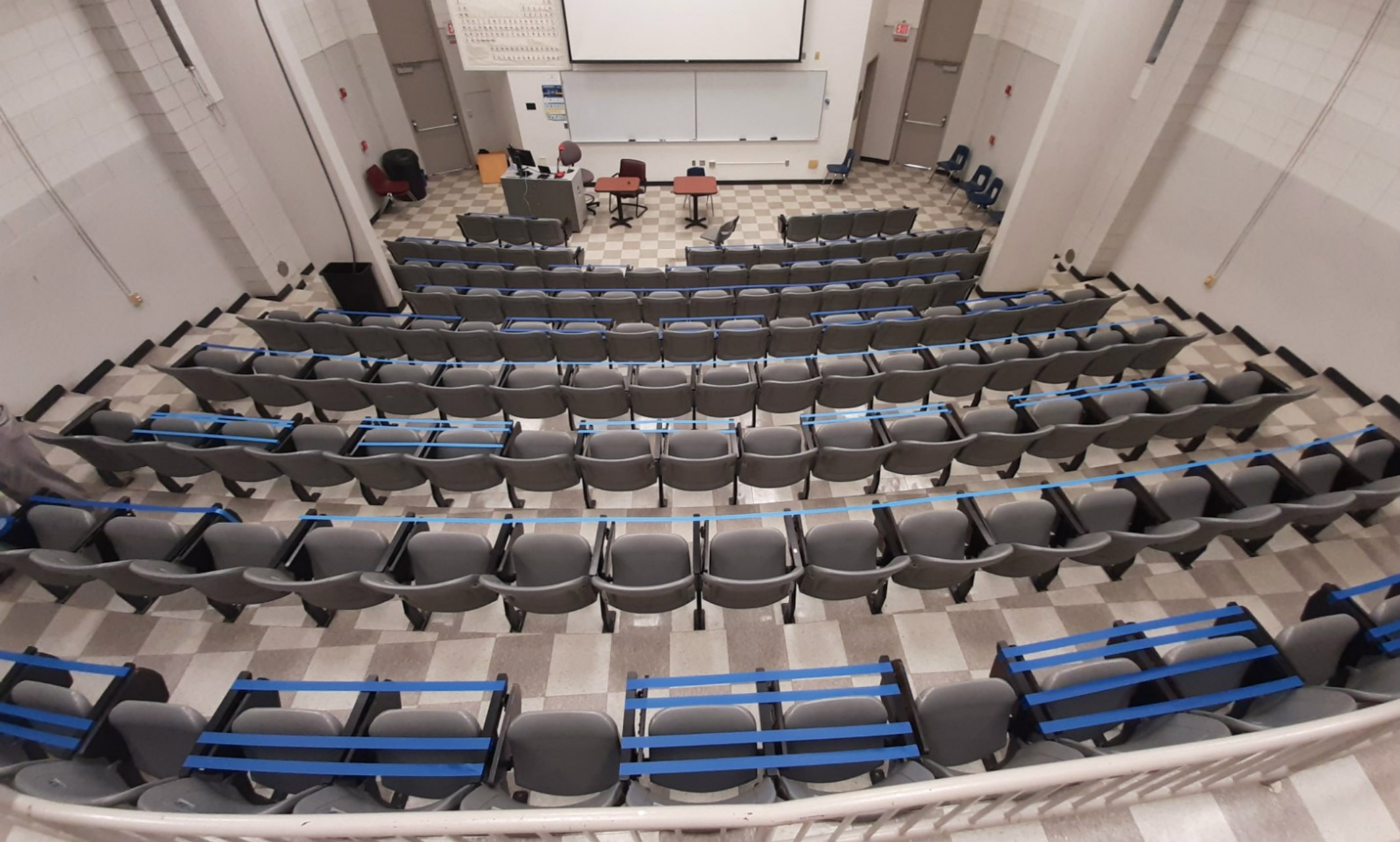 An auditorium in Royall Hall has taped off seating to allow for six feet of physical distancing.