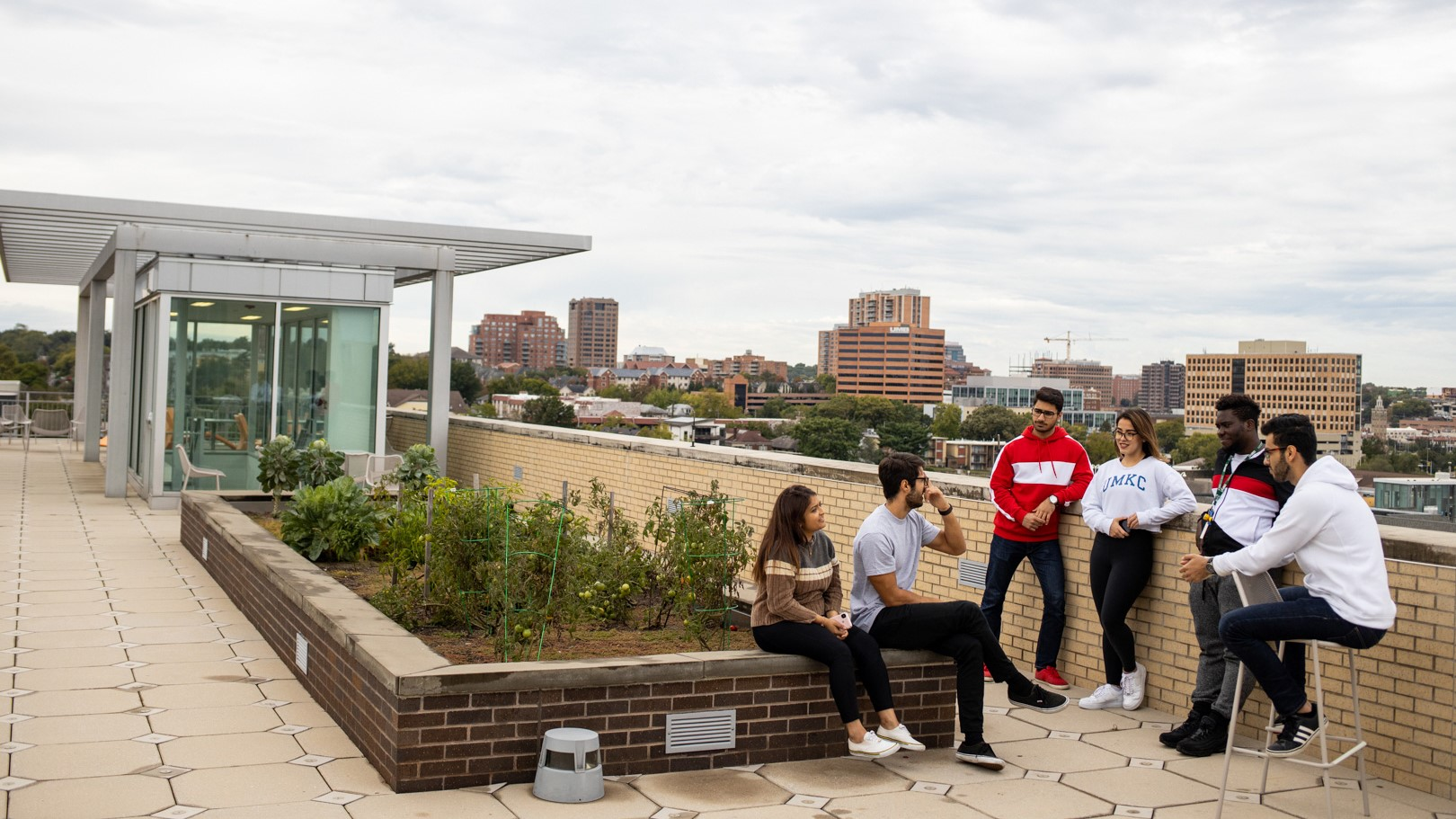 Students sit on the roof of the Atterbury Student Success Center